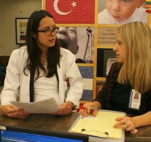 Dr. Juanita Heersink - UAB Resident, discusses a case with the social worker.