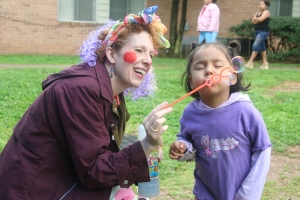 Lisa Fenton shares the joy of bubbles with a young friend.