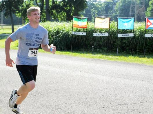 Manzella, Elias - nearing the finish line at Run with the Nations - 2013