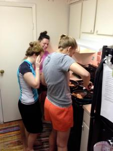 Students making breakfast in their apt
