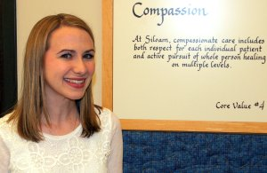 Roddy, Lauren - next to Compassion sign