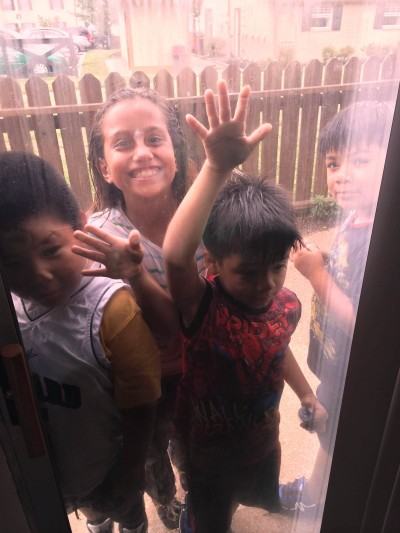 Neighbor children know that fun and attention await them just on the other side of the CHI students' back door.