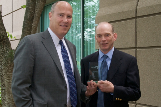 Dr. Morgan Wills, President and CEO of Siloam Family Health Center and Mark McCaw, Siloam Institute Director receive the 2014 Community Service Award given by the Tennessee Medical Association.