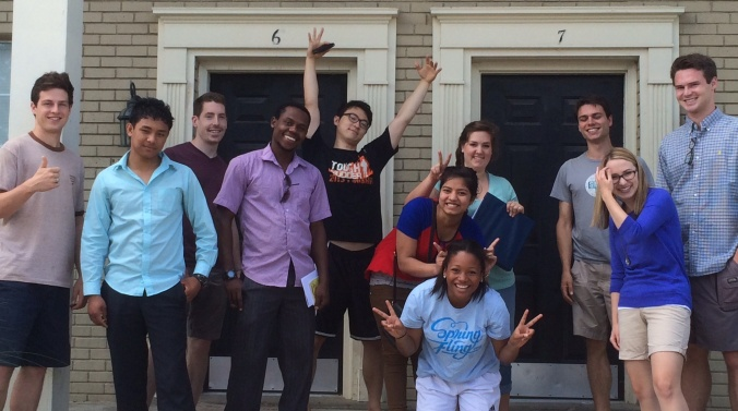 Lay Health Workers and CHI Students pose outside their apartment - 2014 - cropped